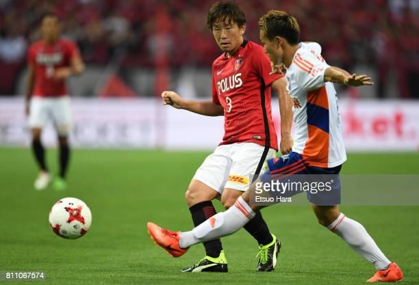 Tomoya Ugajin of Urawa Red Diamonds and Kei Koizumi of Albirex Niigata compete for the ball during the JLeague J1 match between Urawa Red Diamonds...