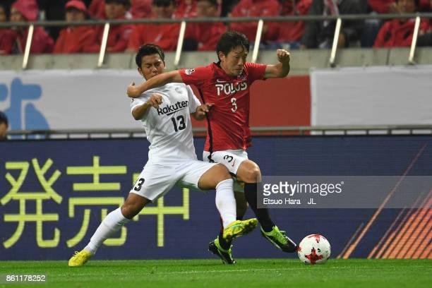 Tomoya Ugajin of Urawa Red Diamonds and Keijiro Ogawa of Vissel Kobe compete for the bal during the JLeague J1 match between Urawa Red Diamonds and...