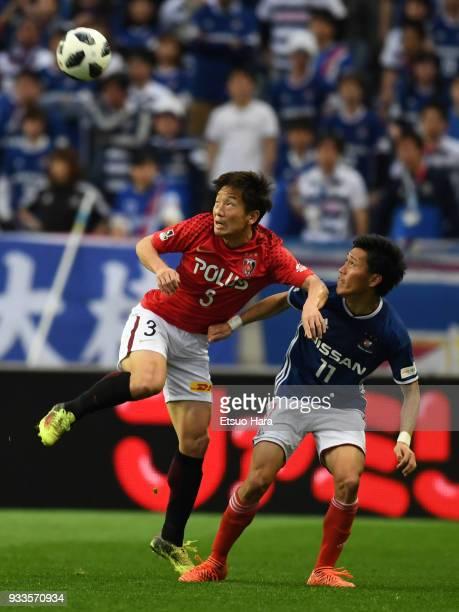 Tomoya Ugajin of Urawa Red Diamonds and Keita Endo of Yokohama FMarinos compete for the ball during the JLeague J1 match between Urawa Red Diamonds...