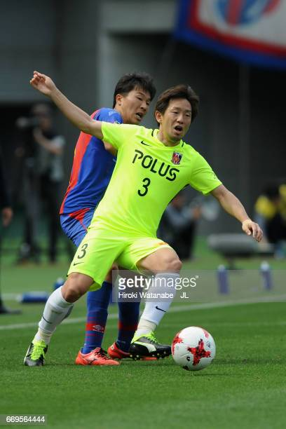 Tomoya Ugajin of Urawa Red Diamonds and Kensuke Nagai of FC Tokyo compete for the ball during the J.League J1 match between FC Tokyo and Urawa Red...