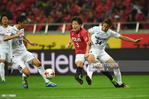 Tomoya Ugajin of Urawa Red Diamonds and So Fujitani of Vissel Kobe compete for the ball during the JLeague J1 match between Urawa Red Diamonds and...