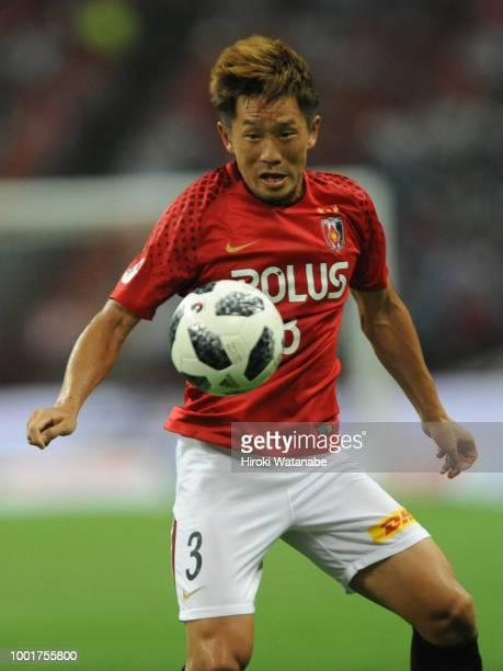 Tomoya Ugajin of Urawa Red Diamonds in action during the J.League J1 match between Urawa Red Diamonds and Nagoya Grampus at Saitama Stadium on July...