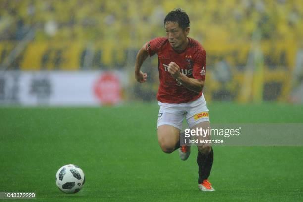 Tomoya Ugajin of Urawa Red Diamonds in action during the J.League J1 match between Urawa Red Diamonds and Kashiwa Reysol at Saitama Stadium on...
