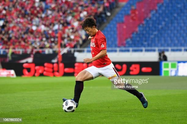 Tomoya Ugajin of Urawa Red Diamonds in action during the J.League J1 match between Urawa Red Diamonds and Gamba Osaka at Saitama Stadium on November...