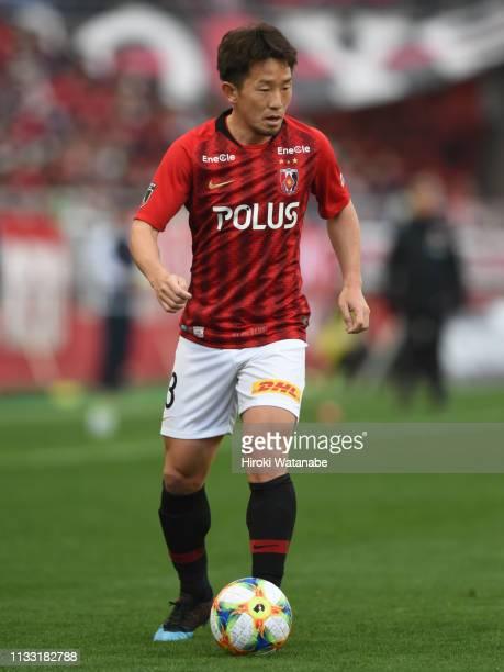 Tomoya Ugajin of Urawa Red Diamonds in action during the J.League J1 match between Urawa Red Diamonds and Consadole Sapporo at Saitama Stadium on...
