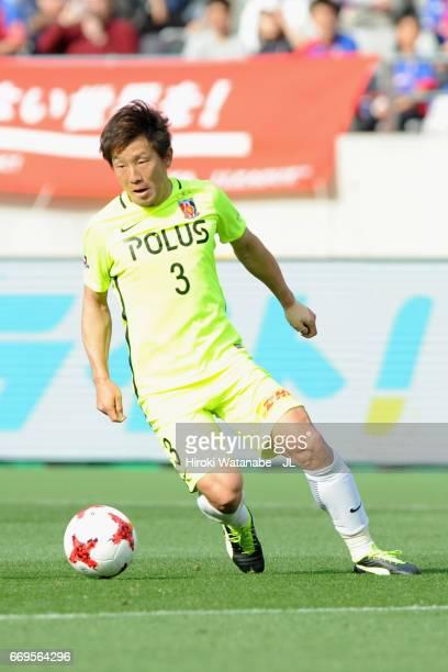 Tomoya Ugajin of Urawa Red Diamonds in action during the J.League J1 match between FC Tokyo and Urawa Red Diamonds at Ajinomoto Stadium on April 16,...