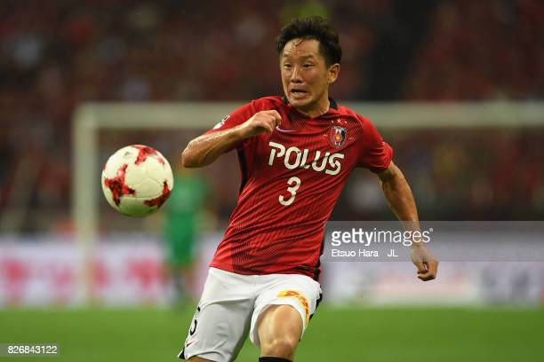 Tomoya Ugajin of Urawa Red Diamonds in action during the J.League J1 match between Urawa Red Diamonds and Omiya Ardija at Saitama Stadium on August...
