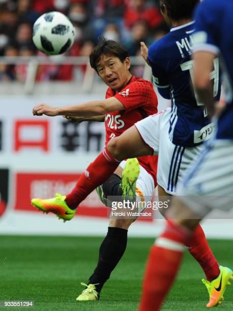 Tomoya Ugajin of Urawa Red Diamonds in action during the JLeague J1 match between Urawa Red Diamonds and Yokohama FMarinos at Saitama Stadium on...