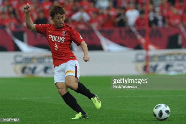 Tomoya Ugajin of Urawa Red Diamonds in action during the JLeague J1 match between Urawa Red Diamonds and Consadole Sapporo at Saitama Stadium on...