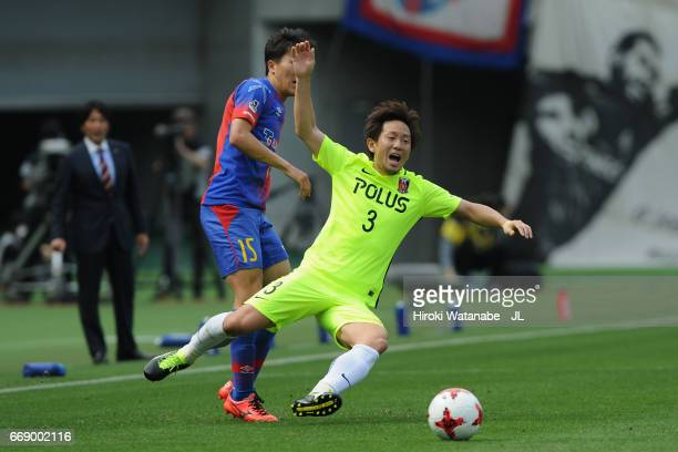 Tomoya Ugajin of Urawa Red Diamonds is challenged Kensuke Nagai of FC Tokyo during the J.League J1 match between FC Tokyo and Urawa Red Diamonds at...
