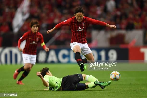 Tomoya Ugajin of Urawa Red Diamonds is taclked during the AFC Champions League Group G match between Urawa Red Diamonds and Jeonbuk Hyundai Motors at...