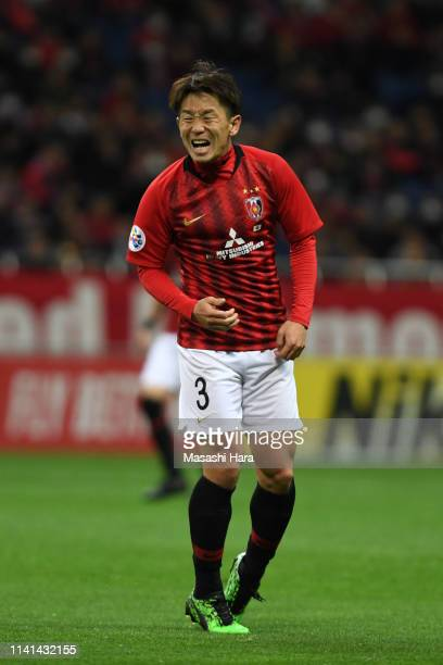 Tomoya Ugajin of Urawa Red Diamonds reacts after missing a chance during the AFC Champions League Group G match between Urawa Red Diamonds and...