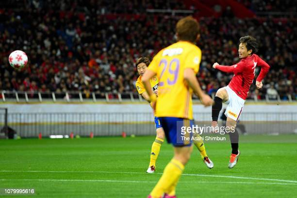 Tomoya Ugajin of Urawa Red Diamonds scores the opening goal during the 98th Emperor's Cup Final between Urawa Red Diamonds and Vegalta Sendai at...