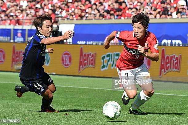Tomoya Ugajin of Urawa Red Diamonds#3 and Shu Kurata of Gamba Osaka#11 compete for the ball during the J.League Levain Cup Final match between Gamba...