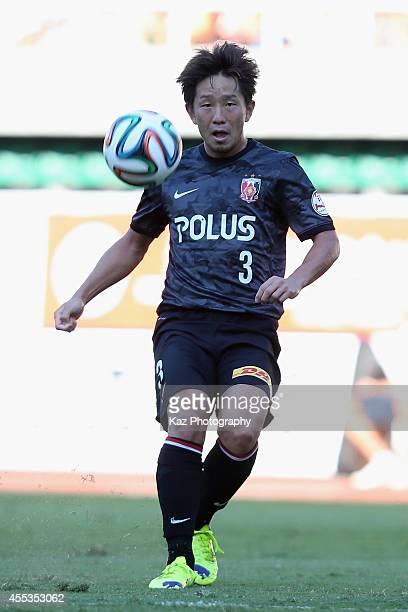 Tomoya Ugajin of Urawa Reds in action during the J.League match between Shimizu S-Pulse and Urawa Red Diamonds at Ecopa Stadium on September 13, 2014...