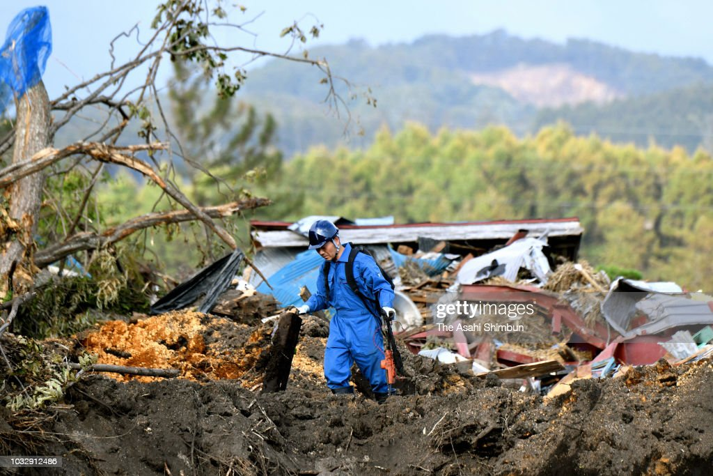 Tomoya Umehara, 38, stands at a landslide site a week after the magnitude 6.7 earthquake on September 13, 2018 in Atsuma, Hokkaido, Japan. Concerns are rising about the health of the evacuees because prolonged life in shelters can pose serious risks. Living away from home and together with strangers puts enormous mental and physical strains on evacuees.