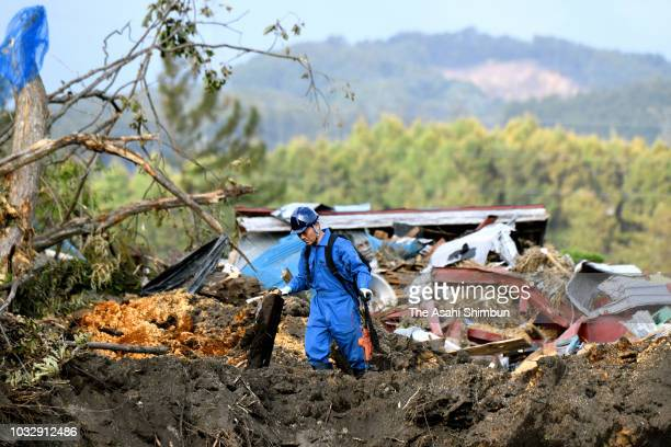 Tomoya Umehara stands at a landslide site a week after the magnitude 67 earthquake on September 13 2018 in Atsuma Hokkaido Japan Concerns are rising...