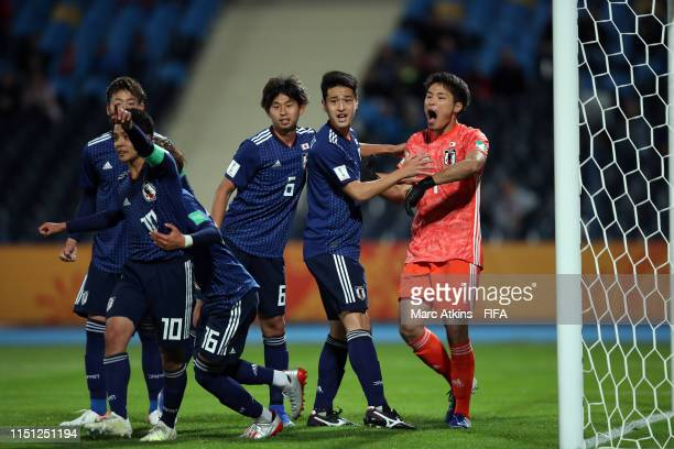 Tomoya Wakahara of Japan celebrates with team mates after saving a penalty during the 2019 FIFA U-20 World Cup group B match between Japan and...