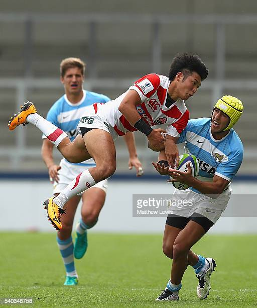 Tomoya Yamamura of Japan and Jose BarrosSosa of Argentina challenge for the ball during the World Rugby U20 Championship match between Argentina and...