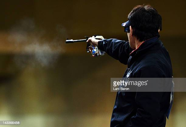Tomoyuki Matsuda of Japan in action during the Men's 50m Pistol Final on day seven of the ISSF Shooting World Cup LOCOG Test Event for London 2012 at...