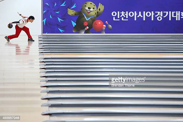 Tomoyuki Sasaki of Japan competes in Group B of the Men's Singles Final during day four of the 2014 Asian Games at Anyang Hogye Stadium on September...
