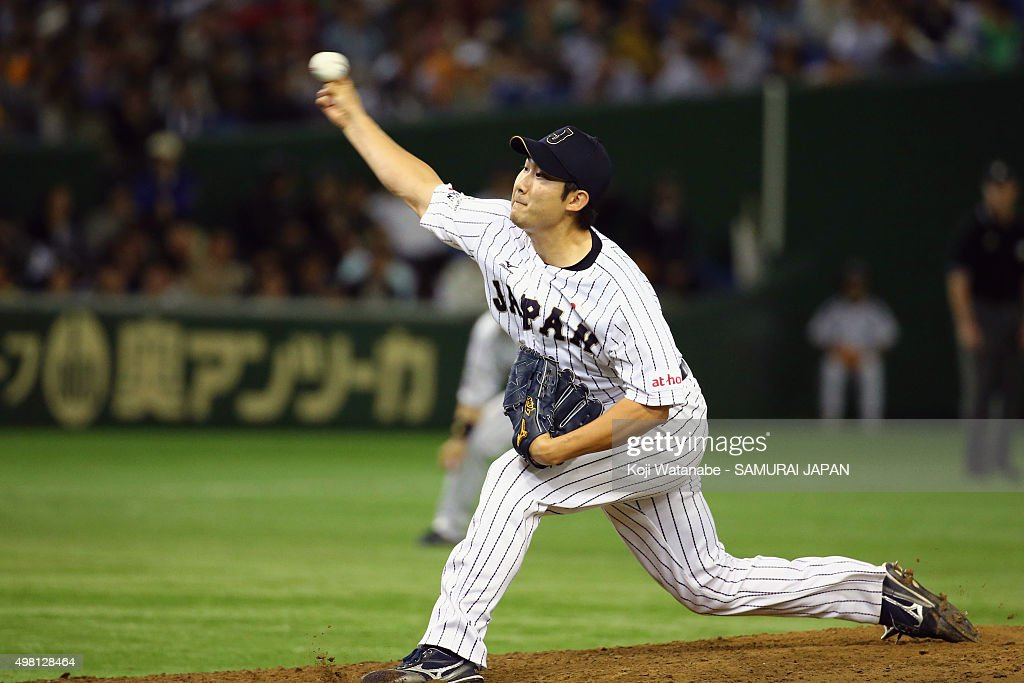 Tomoyuki Sugano #11 of Japan pitches in the top half of sixth inning during the WBSC Premier 12 third place play off match between Japan and Mexico at the Tokyo Dome on November 21, 2015 in Tokyo, Japan.