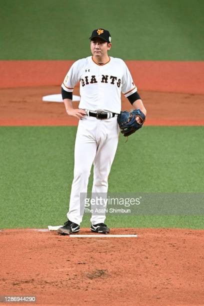 Tomoyuki Sugano of the Yomiuri Giants reacts after allowing a two run home run to Ryoya Kurihara of the Fukuoka SoftBank Hawks to make it 0-2 in the...