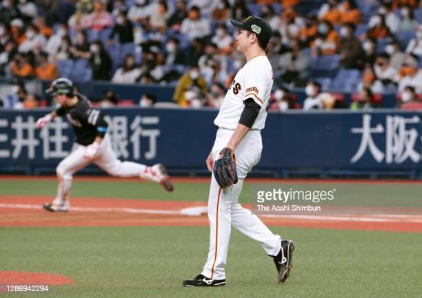 Tomoyuki Sugano of the Yomiuri Giants reacts after allowing the two-run double to Ryoya Kurihara of the Fukuoka SoftBank Hawks in the 6th inning...