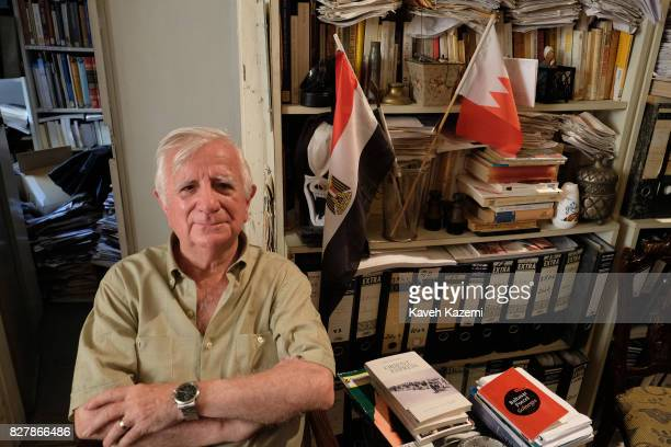 Tomás Alcoverro the Spanish journalist who has worked for La Vanguardia newspaper in Catalonia Spain seen in his office filled with booksfiles and...