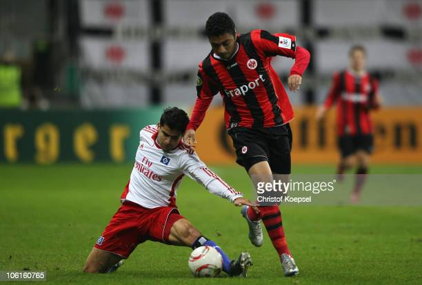 Tomás Rincón of Hamburg challengesllenges Caio of Frankfurt during the DFB Cup match between Eintracht Frankfurt and Hamburger SV at Commerzbank...