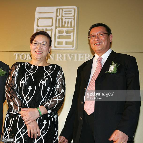 Tomson Group chairman Hsu Feng and general manager Hsu Bin attend a promotion event to sell apartments of Tomson Riviera the most expensive apartment...