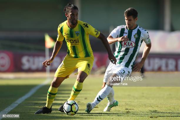Tondela forward Heliardo from Brazil with Vitoria Setubal defender Frederico Venancio from Portugal in action during the League Cup match between...