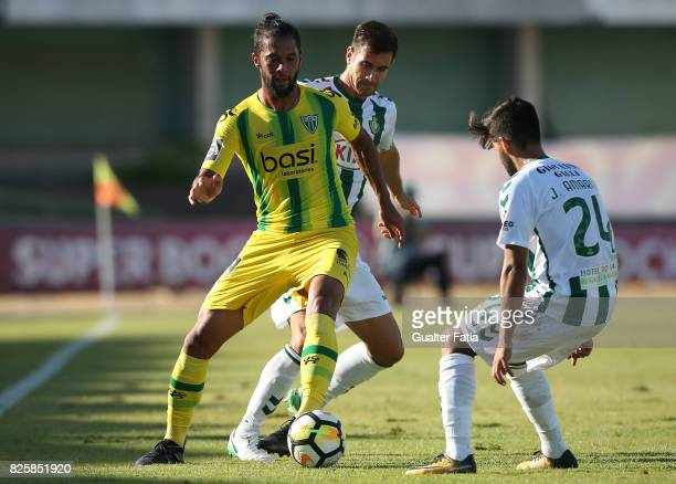Tondela forward Heliardo from Brazil with Vitoria Setubal defender Frederico Venancio from Portugal and Vitoria Setubal forward Joao Amaral from...
