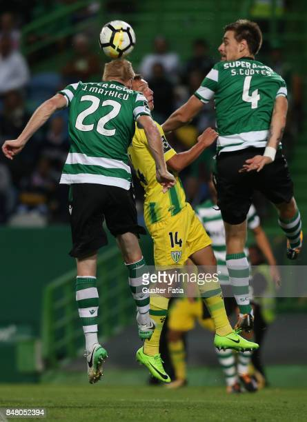 Tondela forward Mateusz Zachara from Poland with Sporting CP defender Jeremy Mathieu from France and Sporting CP defender Sebastian Coates from...