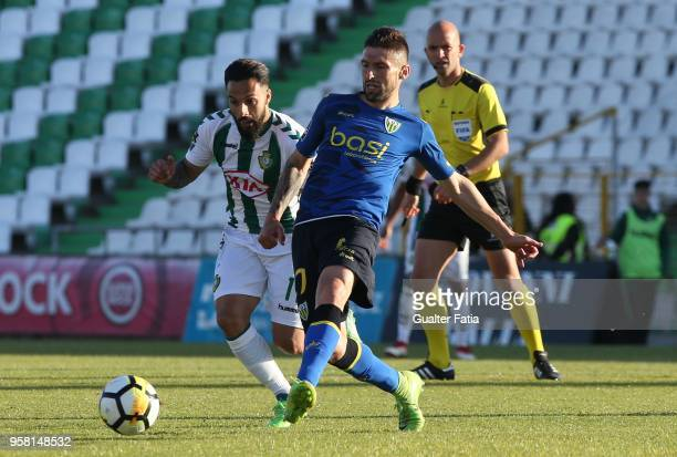 Tondela midfielder Bruno Monteiro from Portugal with Vitoria Setubal midfielder Joao Costinha from Portugal in action during the Primeira Liga match...
