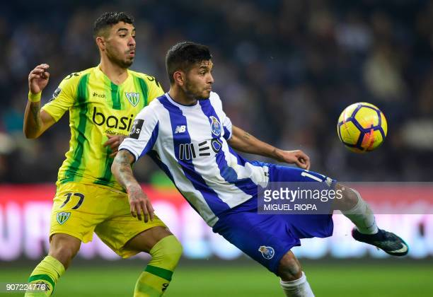Tondela's Brazilian forward Murilo Freitas vies with Porto's Mexican forward Jesus Corona during the Portuguese league football match between FC...