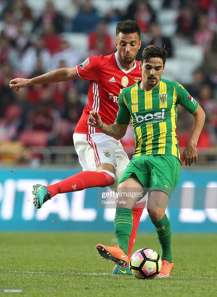 Tondela's midfielder Claude Goncalves from Portugal with SL BenficaÕs midfielder from Greece Andreas Samaris in action during the Primeira Liga match between SL Benfica and CD Tondela at Estadio da Luz on January 22, 2017 in Lisbon, Portugal.