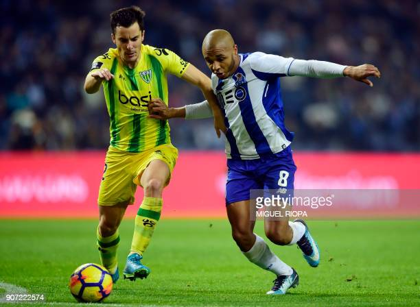Tondela's Portuguese defender David Bruno vies with Porto's Algerian forward Yacine Brahimi during the Portuguese league football match between FC...