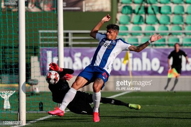 CD Tondela's Senegalese goalkeeper Babacar Niasse blocks a shot on goal by FC Porto's Brazilian forward Tiquinho Soares during the Portuguese League...