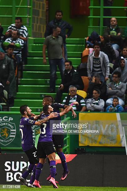 Tondela's Venezuelan forward John Murillo celebrates with his teammates after scored against Sportin CP during the Portuguese league football match...