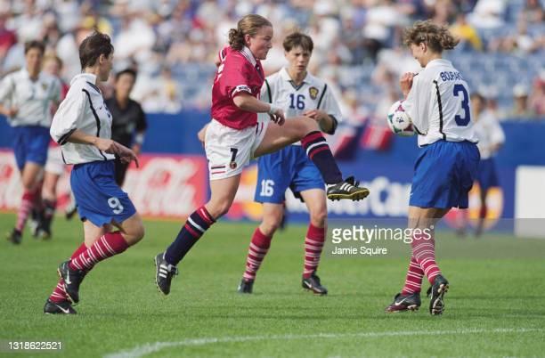 Tone Gunn Frustol, Midfielder for Norway strikes the football as Marina Burakova of Russia blocks during their Group C match of the FIFA Women's...