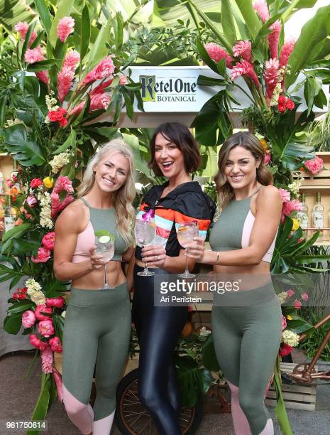 Tone It Up trainers Chyna Rae Karena Dawn and Tori Simeone enjoy a Ketel One Botanical Soda at the Living Botanical bar at the launch of Ketel One...