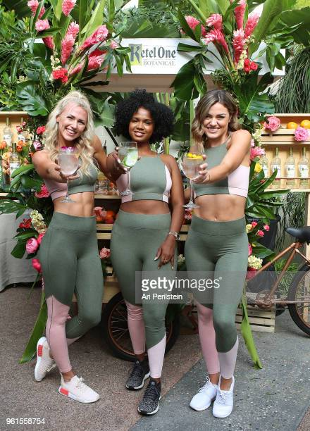 Tone It Up trainers Tori Simeone and Chyna Rae and DJ Brittany Sky enjoy a Ketel One Botanical Soda at the Living Botanical bar at the launch of...