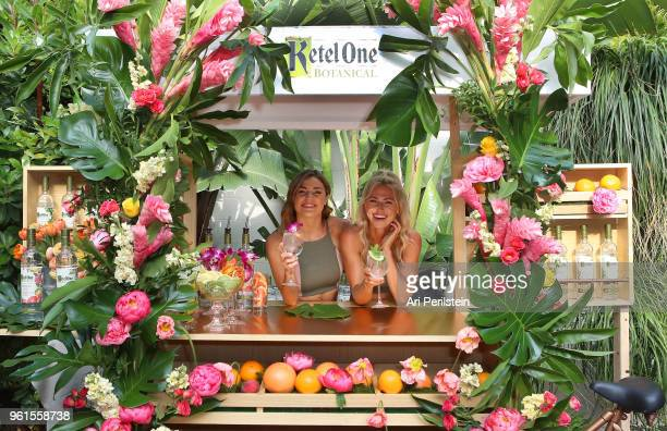Tone It Up trainers Tori Simeone and Chyna Rae enjoy a Ketel One Botanical Soda at the Living Botanical bar at the launch of Ketel One Botanical on...
