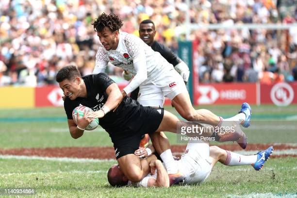 Tone Ng Shiu of New Zealand charges forward against England on day three of the Cathay Pacific/HSBC Hong Kong Sevens at the Hong Kong Stadium on...