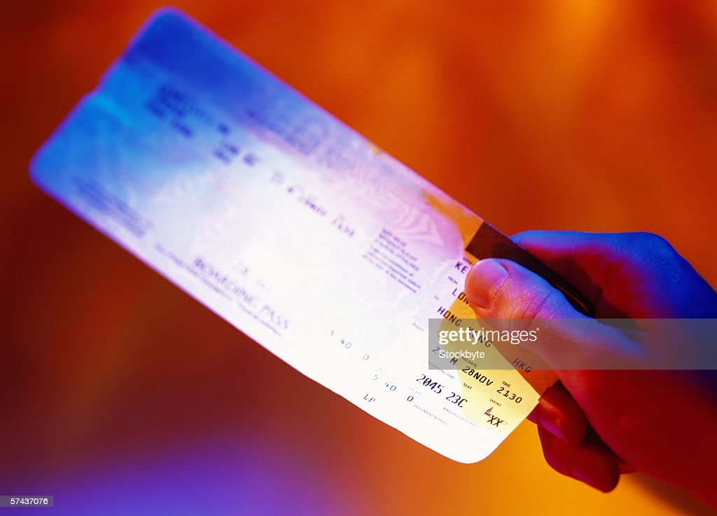 toned close-up of a hand holding a bank cheque : Stock Photo