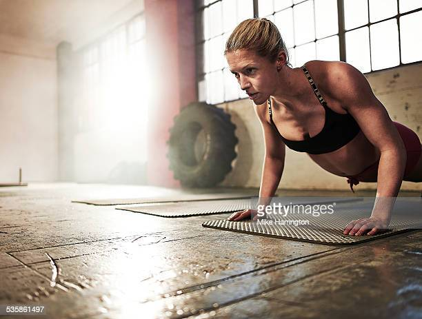 Toned female performing press up