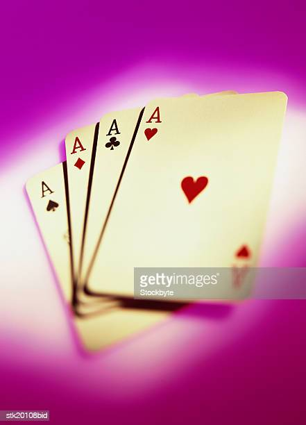 toned high angle view of four aces from a deck of playing cards