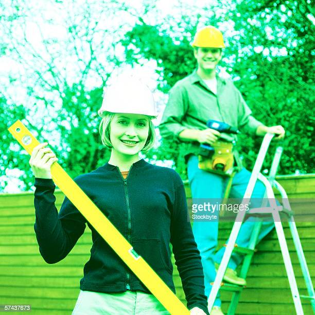 toned view of a couple doing construction work together