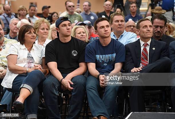 Tonette Walker wife of Wisconsin Gov Scott Walker and their sons Alex Walker and Matt Walker and Nevada Attorney General Adam Laxalt listen as Scott...